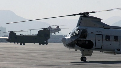 Helicopters await passengers at Kabul International Airport. The danger of the capital has made helicopter rides the safest way to and from the airport. CBS NEWS